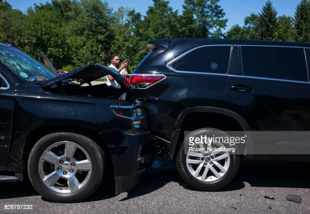 Two cars sit at a standstill after colliding July 30 2017 along the New York State Thruway in Plattekill New York New York State Police and emergency...