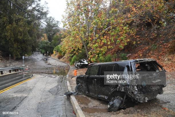 Two cars washed downhill in a raindriven mudslide are seen in a neighborhood under mandatory evacuation in Burbank California January 9 2018...