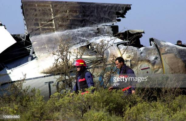 Two cash of firemen pass in front of rest of the military airplane Fokker F27 the 17 of May of 2001 in the airport of the province of Mendoza...
