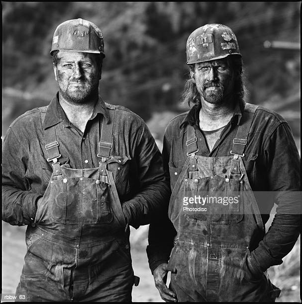 two caucasian coal miners pause at work for a picture - coal miner stock photos and pictures