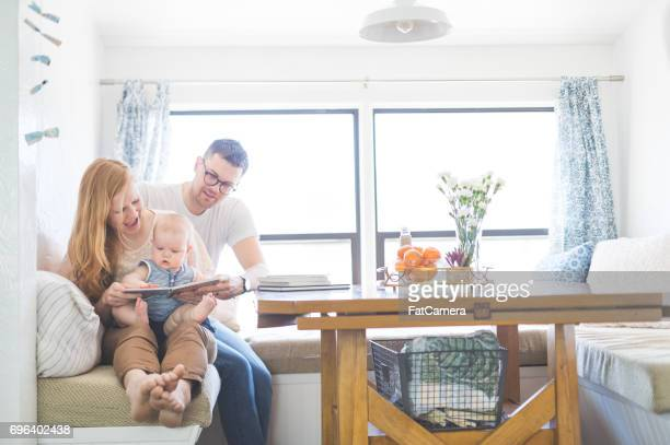 two caucasian parents play and spend time with their baby - fat women in bath stock pictures, royalty-free photos & images