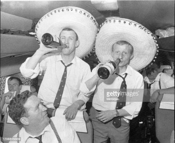 Two Celtic Players enjoy their champagne on the plane home while manager Jock Stein sitting in front looks back at them. Celtic have just beaten...