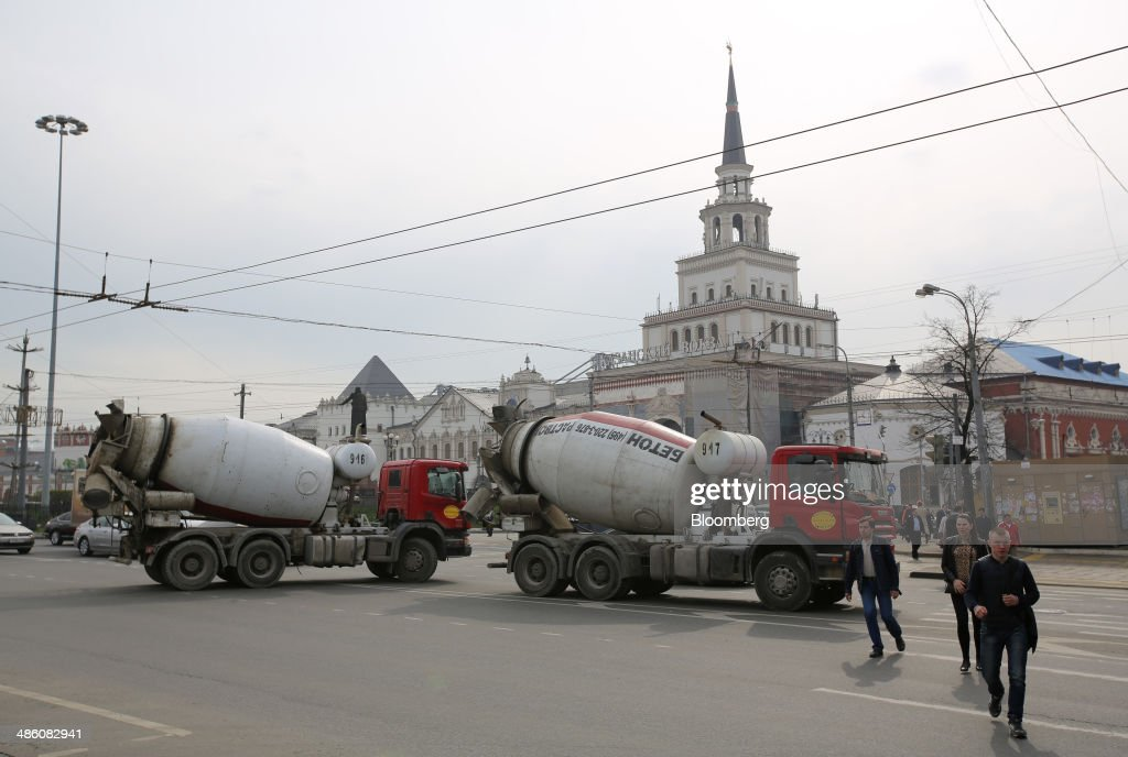 Two cement mixing trucks pass Kazansky railway station, center, in Moscow, Russia, on Tuesday, April 22, 2014. Bankers collected $108 million on Russian deals through April 20, compared with $325 million a year earlier, according to data from Freeman & Co., a New York consulting firm. Photographer: Andrey Rudakov/Bloomberg via Getty Images
