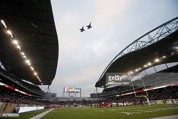 Two CF-18 Hornets fly by after the national anthem prior to the start of a CFL game between the Winnipeg Blue Bombers and Calgary Stampeders at...