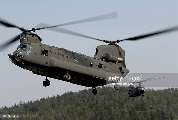 Two CH-47 Chinook helicopters in flight.