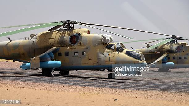 Two Chadian army helicopters are pictured at the airport of Diffa southeastern Niger near the border with Nigeria on May 22 2015 AFP PHOTO / ISSOUF...