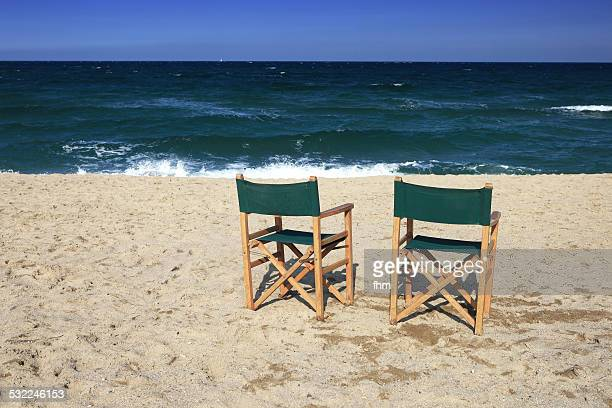 Two chairs on empty beach