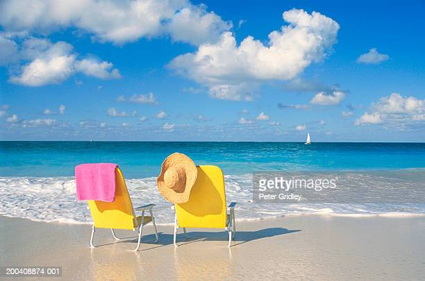 Two chairs on the beach, rear view