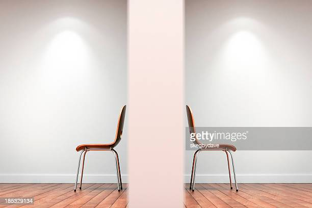 Two chairs split by wall