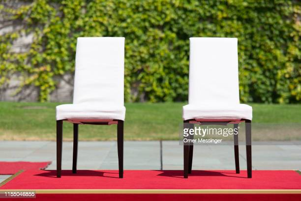 Two chairs stand in the center of the ceremony yard prior to a meeting between German Chancellor Angela Merkel and new Danish Prime Minister Mette...
