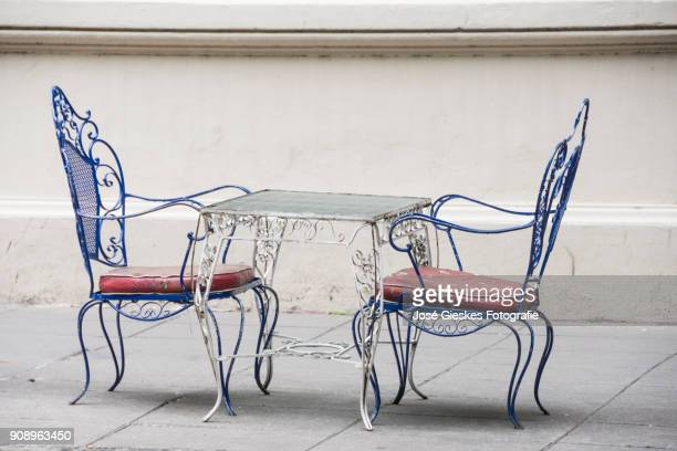 two chairss on the sidewalk in Buenos Aires streets