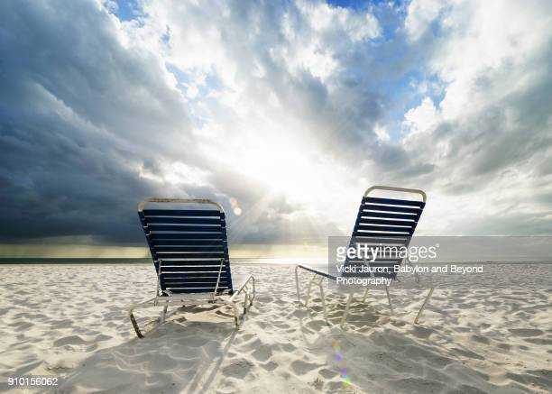 two chaise lounge chairs and gulf of mexico at fort myers beach - fort myers beach stock pictures, royalty-free photos & images