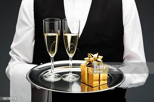 two champagne flutes and gift