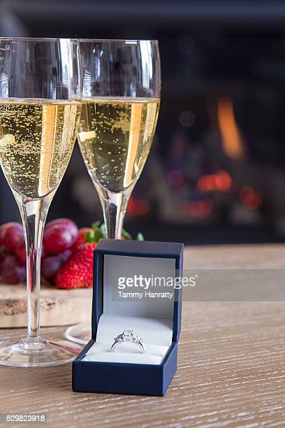 Two champagne glasses and engagement ring