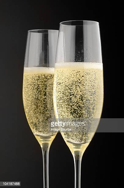 Two champagne glasses with champagne