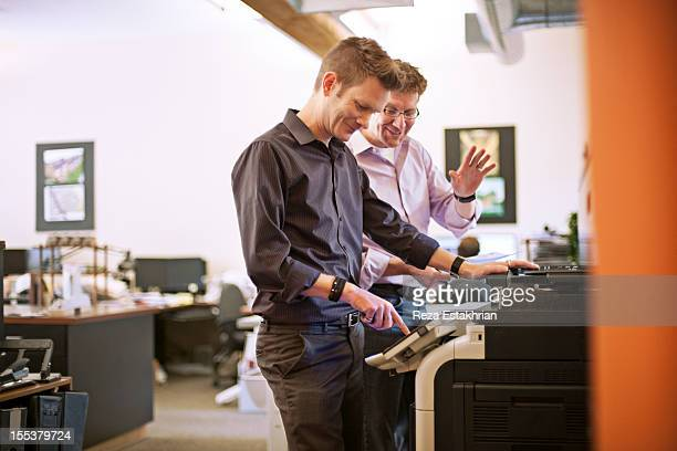 Two chat by photocopier