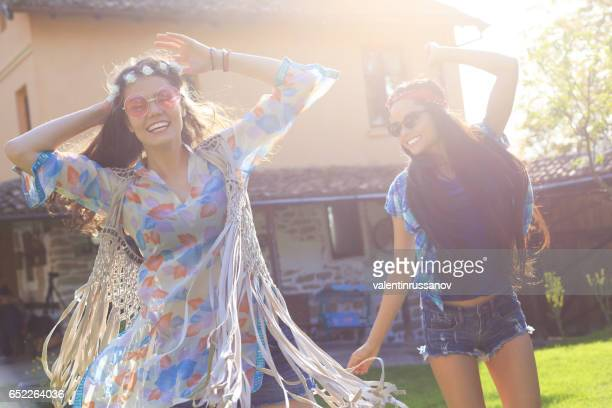 two cheerful boho friends dancing on back yard - bulgarian girl stock photos and pictures