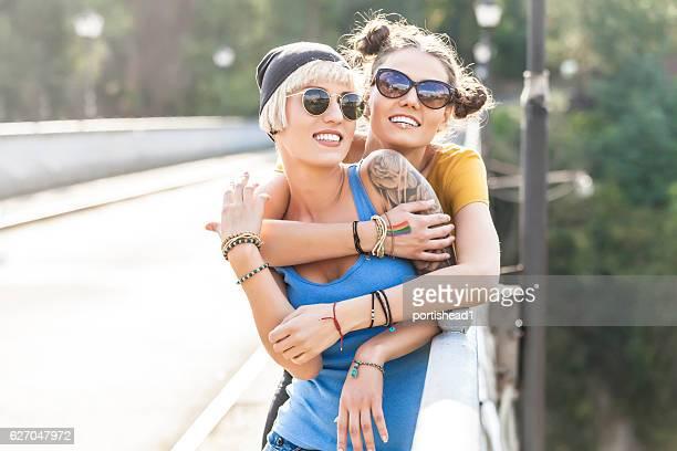 Two cheerful women having fun on bridge