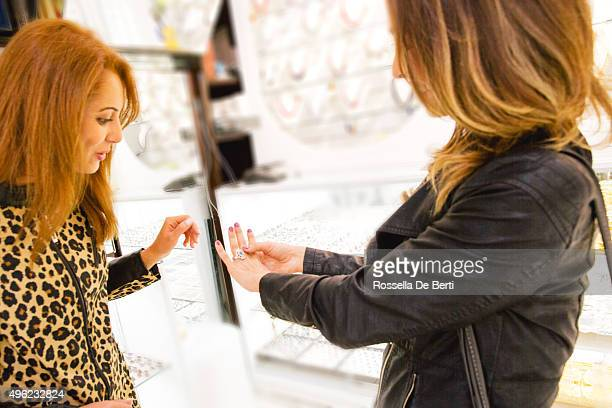 Two Cheerful Women In A Jewelry Store