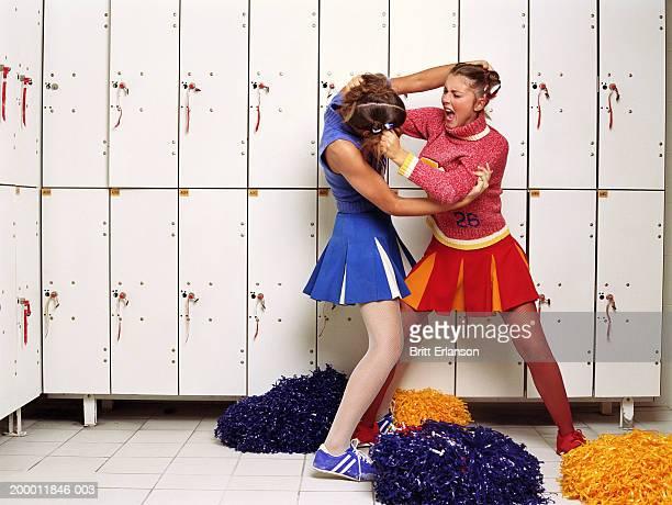 Two cheerleaders in locker room fighting