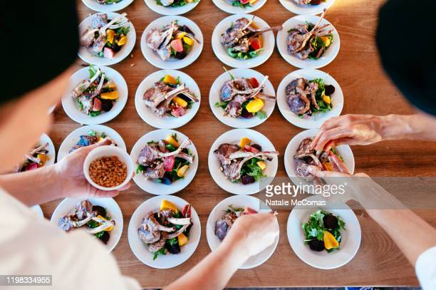 two chefs creating meals for an event - pacific islands stock pictures, royalty-free photos & images