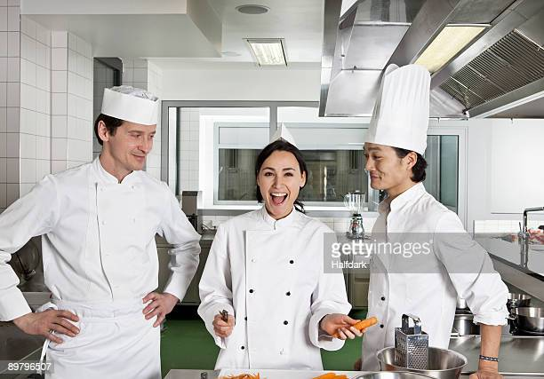 Two chefs teasing another chef