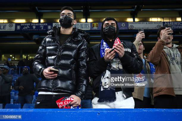Two Chelsea fans wearing black face mask as protection from Coronavirus ahead of the FA Cup Fifth Round match between Chelsea and Liverpool at...