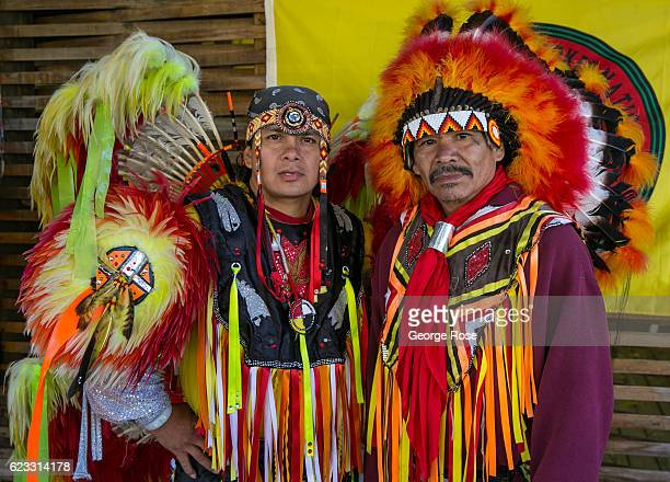 Two Cherokee Native American dancers pose for pictures along the highway on October 22 2016 in Cherokee North Carolina Located near the entrance to...