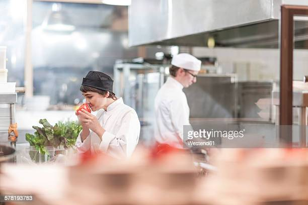 Two ches preparing food in restaurant kitchen