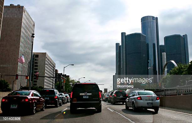 Two Chevrolet vehicles and a Cadillac Escalade sit in traffic near the headquarters of General Motors Co. In Detroit, Michigan, U.S., on Tuesday,...