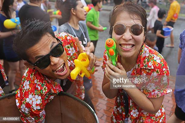 Two Chiang Mai residents celebrate Songkran by taking part in a massive citywide water fight on April 13 2014 in Chiang Mai Thailand Songkran is the...