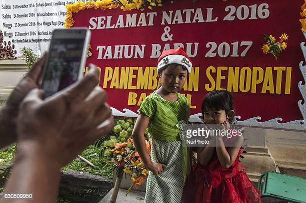 Two child photographed together when attend mass in celebration of Christmas in Sacred Heart of Jesus Catholic Church in Yogyakarta Indonesia on...