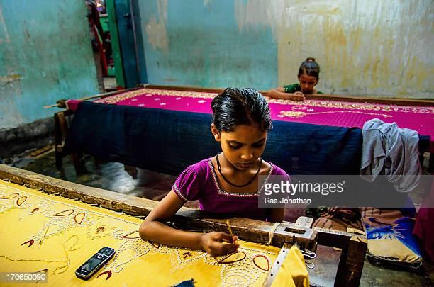 Two children are decorating a saree one of the mean income of the Bihari's in the Bihari camp the Bihari are the Urdu speaking Muslim community in...