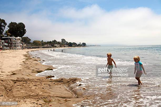 Two children at Miramar Beach on the Pacific Ocean Montecito is a wealthy beach community along California's Pacific Coast highway Oprah Winfrey Rob...