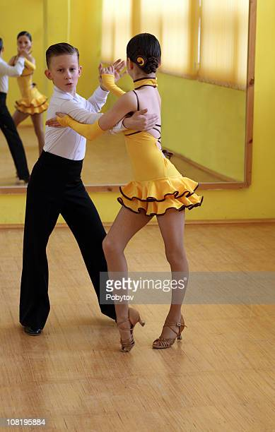 two children ballroom dancing - salsa dancing stock photos and pictures