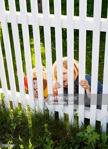 Two children behind a fence Sweden.