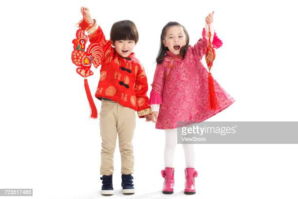 Two children celebrate the new year