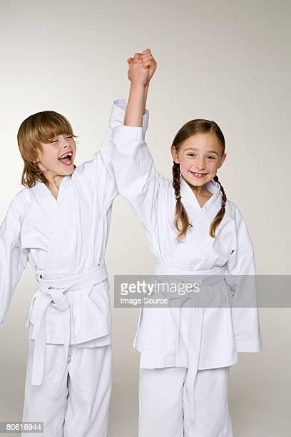 Two children celebrating