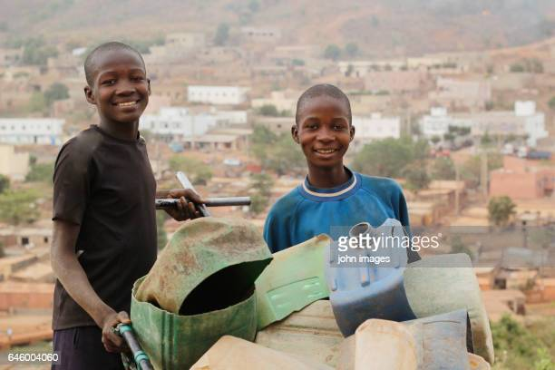 Two children collecting the plastic cans
