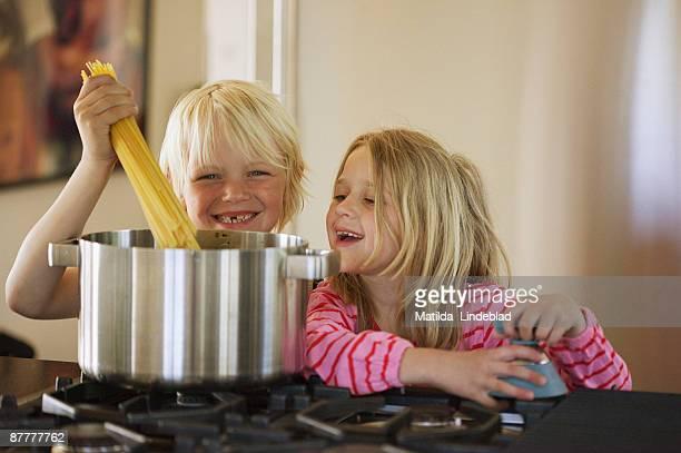 Two children cooking Sweden.
