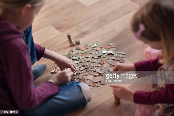 Two children counting out pocket money