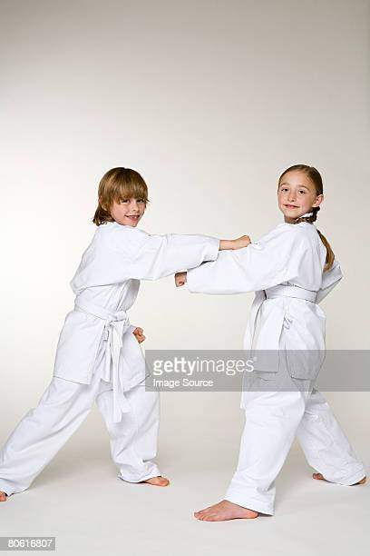 Two children doing karate punches