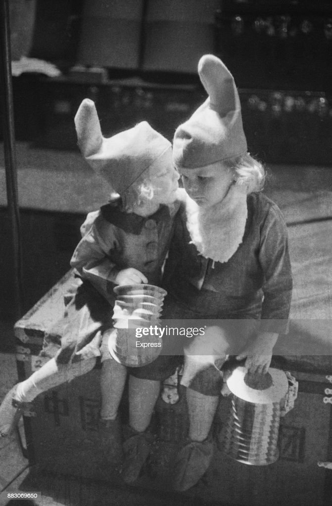 Two children dressed as gnomes, during a recital organized by The Children's Society, London, UK, 16th July 1958.