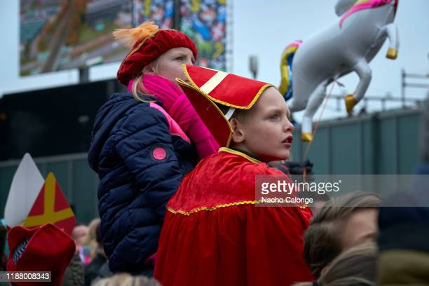 Two children dressed as Zwarte Piet and Sinterklaas wait for the parade to begin in the celebration of the arrival of Sinterklaas on November 16 2019...