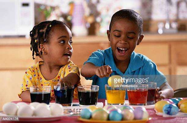 Two Children Dyeing Easter Eggs