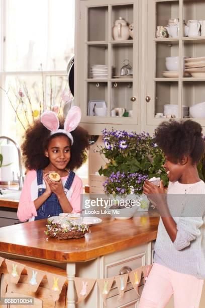 Two children easting Easter cake