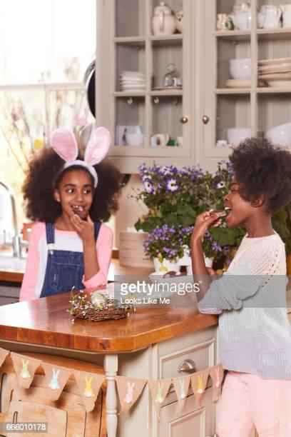 Two children eating Easter cake.