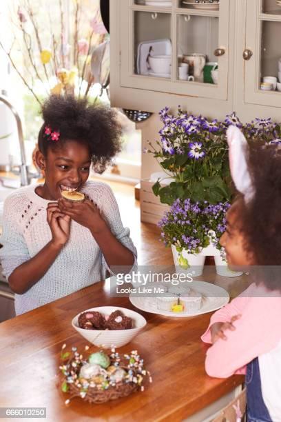 Two children eating easter cake
