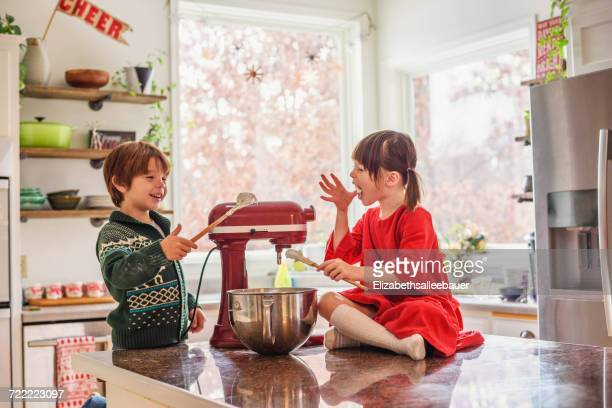 two children eating raw cookie dough - electric mixer stock pictures, royalty-free photos & images