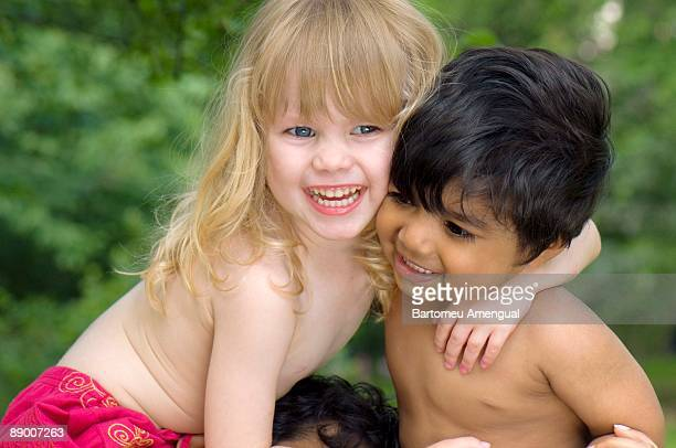 Two children embracing outdoors